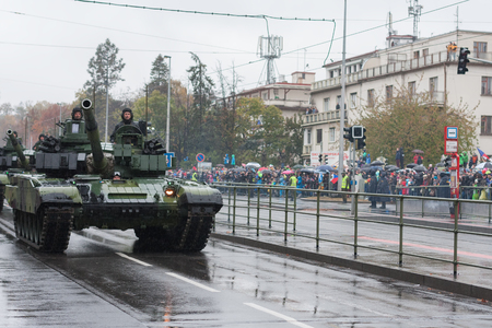 European street, Prague-October 28, 2018: Soldiers of Czech Army are riding main battle tank T-24M4 CZ on military parade on October 28, 2018 in Prague, Czech Republic