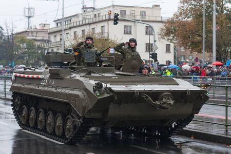 European street, Prague-October 28, 2018: Soldiers of Czech Army are riding  recovery tracked vehicle VPV  on military parade on October 28, 2018 in Prague, Czech Republic