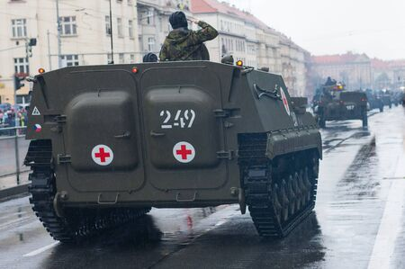 European street, Prague-October 28, 2018: Soldiers of Czech Army are riding armored ambulance vehicle on military parade on October 28, 2018 in Prague, Czech Republic 에디토리얼