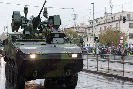 European street, Prague-October 28, 2018: Soldiers of Czech Army are riding wheeled  infantry fighting vehicle Pandur CZ on military parade on October 28, 2018 in Prague, Czech Republic