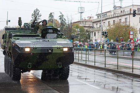 European street, Prague-October 28, 2018: Soldiers of Czech Army are riding wheeled reconnaissance vehicle Pandur CZ on military parade on October 28, 2018 in Prague, Czech Republic