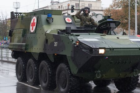 European street, Prague-October 28, 2018: Soldiers of Czech Army are riding armored medical vehicle Pandur on military parade on October 28, 2018 in Prague, Czech Republic
