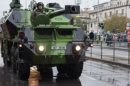 European street, Prague-October 28, 2018: Soldiers of Czech Army are riding wheeled self-propelled howitzer cannon Dana 77 on military parade on October 28, 2018 in Prague, Czech Republic