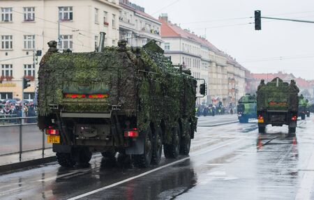 European street, Prague-October 28, 2018: Soldiers of Czech Army are riding wheeled mortar carrier Tatra 815-7 Pram  on military parade on October 28, 2018 in Prague, Czech Republic