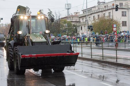 European street, Prague-October 28, 2018: Soldiers of Czech Army are riding backhoe loader JCB 4CX on military parade on October 28, 2018 in Prague, Czech Republic