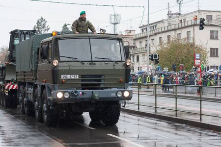 European street, Prague-October 28, 2018: Soldiers of Czech Army are riding military truck with bulldozer  on military parade on October 28, 2018 in Prague, Czech Republic