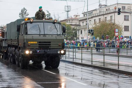European street, Prague-October 28, 2018: Soldiers of Czech Army are riding military truck with mine clearing vehicle on military parade on October 28, 2018 in Prague, Czech Republic