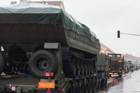 European street, Prague-October 28, 2018: Soldiers of Czech Army are riding military truck with floating transporter on military parade on October 28, 2018 in Prague, Czech Republic 에디토리얼