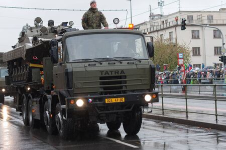 European street, Prague-October 28, 2018: Soldiers of Czech Army are riding military truck with infantry fighting vehicle BMP-2 on military parade on October 28, 2018 in Prague, Czech Republic
