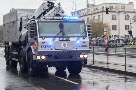 European street, Prague-October 28, 2018: Police workers are riding police truck on military parade on October 28, 2018 in Prague, Czech Republic