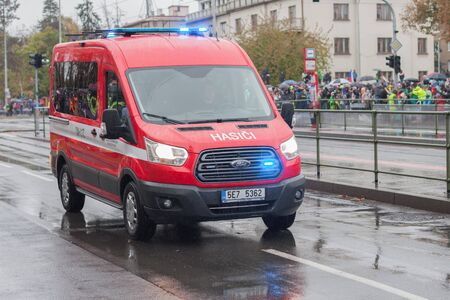 European street, Prague-October 28, 2018: Fire brigade workers riding cars on military parade for 100th anniversary of creation Czechoslovakia on October 28, 2018 in Prague, Czech Republic