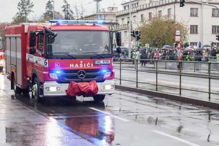 European street, Prague-October 28, 2018: Fire brigade workers  are riding fire truck on military parade on October 28, 2018 in Prague, Czech Republic