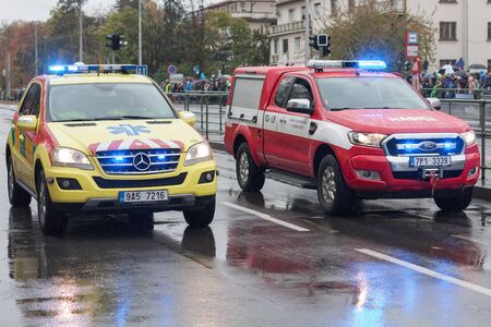 European street, Prague-October 28, 2018: Paramedics and fire brigade workers riding cars on military parade on October 28, 2018 in Prague, Czech Republic