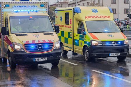 European street, Prague-October 28, 2018: Paramedics are riding ambulance on military parade on October 28, 2018 in Prague, Czech Republic 에디토리얼