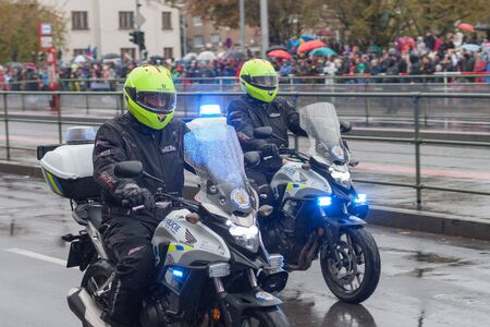 European street, Prague-October 28, 2018: Police workers  are riding motorcycle  on military parade for 100th anniversary of creation Czechoslovakia on October 28, 2018 in Prague, Czech Republic