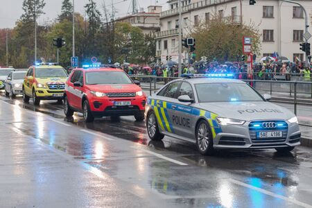 European street, Prague-October 28, 2018: Police workers and Fire brigade workers riding cars on military parade on October 28, 2018 in Prague, Czech Republic 에디토리얼