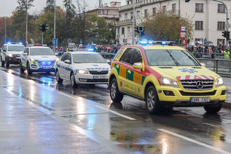 European street, Prague-October 28, 2018: Paramedics are riding ambulance and customs officers riding cars on military parade on October 28, 2018 in Prague, Czech Republic