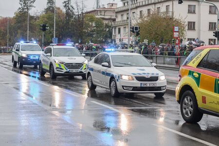 European street, Prague-October 28, 2018: Customs officers riding cars and paramedics are riding ambulance and on military parade on October 28, 2018 in Prague, Czech Republic