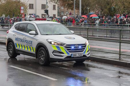 European street, Prague-October 28, 2018: Police worker riding car on military parade for 100th anniversary of creation Czechoslovakia on October 28, 2018 in Prague, Czech Republic