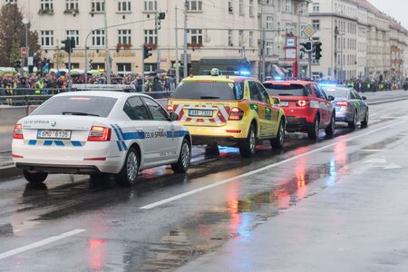 European street, Prague-October 28, 2018: Customs officers and police workers and paramedics and fire brigade workers riding cars on military parade on October 28, 2018 in Prague, Czech Republic