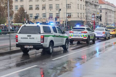 European street, Prague-October 28, 2018: Military Police workers and police workers  riding cars on military parade on October 28, 2018 in Prague, Czech Republic