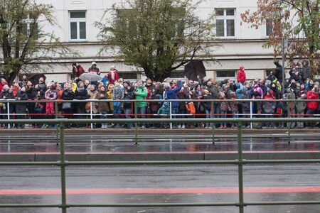 European street, Prague-October 28, 2018: Group of people watching to the sky on police helicopters on military parade on October 28, 2018 in Prague, Czech Republic 에디토리얼