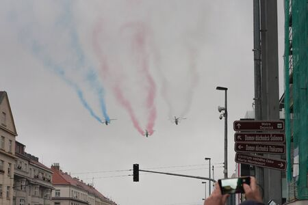 European street, Prague-October 28, 2018: Group of three helicopters with colour smoke on the sky on military parade on October 28, 2018 in Prague, Czech Republic 에디토리얼