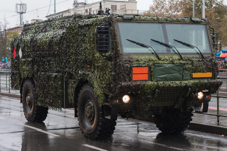Soldiers of Czech Army are riding tank truck on military parade in Prague, Czech Republic