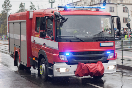 Fire brigade workers are riding fire truck on military parade  in Prague, Czech Republic Stockfoto