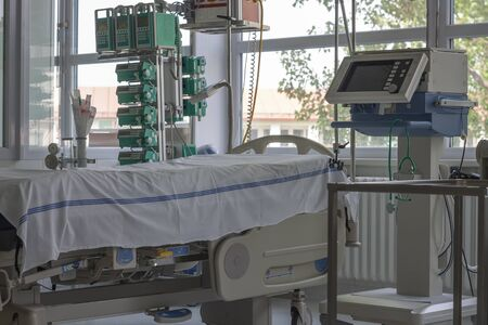 Intensive care unit in hospital, bed with monitor, ventilator, a place where can be  treated patients with pneumonia caused by coronavirus covid 19.