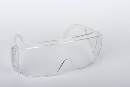 Plastic protective eyeglasses,  personal protective equipment to protect against the virus covid-19.
