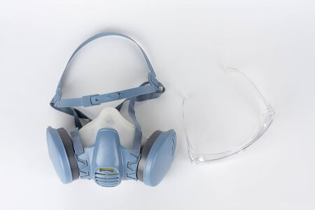 Twin filter half face respirator mask and plastic protective eyglasses,  personal protective equipment to protect against the virus covid-19. Stock Photo