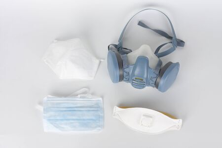 Twin filter half face respirator mask ffp3 , respirator ffp1, ffp2 and face mask, personal protective equipment to protect against the virus covid-19. Stock Photo