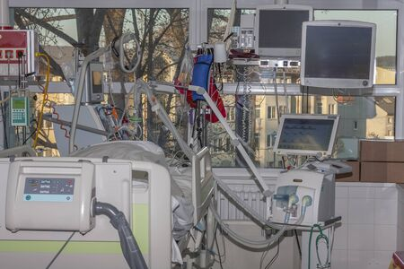 Isolation room in intensive care unit. Patient connected to medical ventilator and dialysis machine . Place where can be treated patients with pneumonia caused by coronavirus covid-19