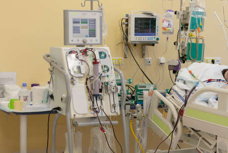 Dialysis machine, to which patient is connected in intensive care unit in hospital. The patient fell ill with a new type of coronavirus covid-19. Foto de archivo