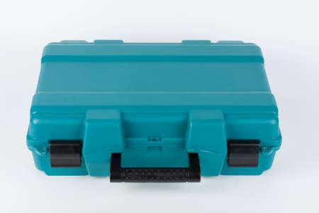 Green carry case for cordless hammer screwdriver drill on white background. Studio shoot.