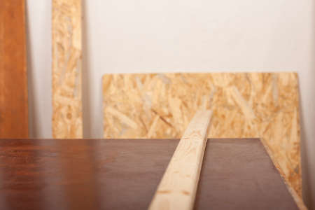 Wooden slat for production of wooden garden bench on table in carpentry workshop
