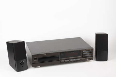 CD Player Stereo Hi-fi and two stereo speakers. High-end audio equipment on a white background.