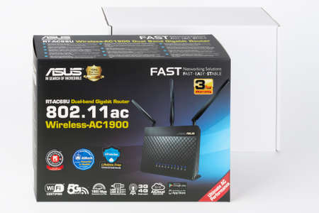 Brnenec, Czech Republic - January 31, 2020: Paper box, inside wifi router Asus RT-AC68U, wireless device with three antennas. Asus is a Taiwanese computer and electronics company. Editorial