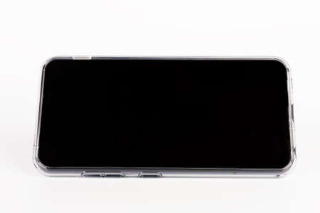 Touchscreen smartphone in silicone cover in white background.