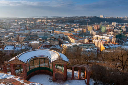 Semicircular big gazebo, nice relaxation site below the castle Spilberk in Brno in Czech Republic. Winter sunrise time. Panoramic view of Brno city.