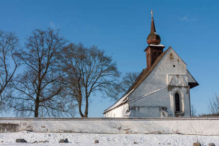 Ancient gothic chapel of the Mother of God near castle Veveri in Czech Republic. Winter time, blue sky. Stock Photo