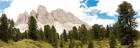 Panorama view from forest of the Geisler or Odle mountains in the Dolomites, Italy