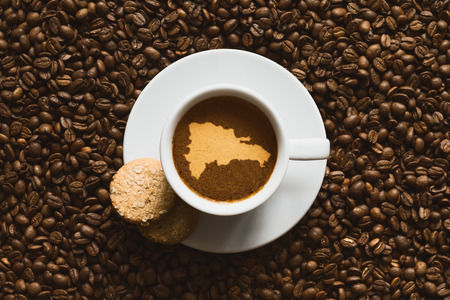 Still life photography of hot coffee beverage with map of Dominican Republic Stock Photo
