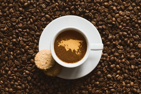 eurasia: Still life photography of hot coffee beverage with map of Eurasia continent