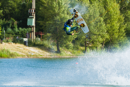 wakeboarding: BRATISLAVA, SLOVAKIA - JUNE 26, 2015: WakeLake Golden Trophy, Contest of Wake-boarding and Wake-skating