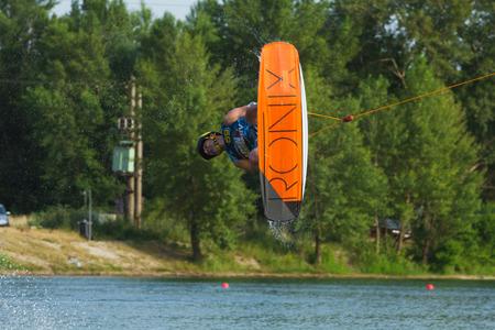 wakeboarding: BRATISLAVA, SLOVAKIA - JUNE 26, 2015: wakeboarder Bernhard Hinterberger jumps while WakeLake Golden Trophy, Contest of Wake-boarding and Wake-skating