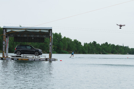 mini car: BRATISLAVA, SLOVAKIA - JUNE 27, 2015: Mini Car on water while WakeLake Golden Trophy, Contest of Wake-boarding and Wake-skating