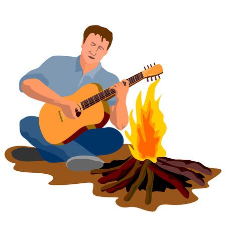 Dude à jouer de la guitare autour du feu de camp