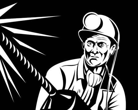 COAL MINER: Coal miner at work with pneumatic drill